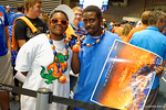 A couple Florida Gator fans pose for the camera while standing at line during the 2014 Florida Gator Fan Day.  August 16th, 2014. Gator Country photo by David Bowie.