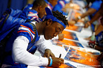 Florida Gator DB Deiondre Porter signs a poster for a fan during the 2014 Florida Gator Fan Day.  August 16th, 2014. Gator Country photo by David Bowie.
