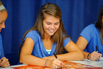 The Florida Gators girls soccer team meets, sign posters and take photos with the fans during the 2014 Florida Gator Fan Day.  August 16th, 2014. Gator Country photo by David Bowie.