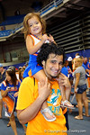 A dad and his daughter wait in line during the 2014 Florida Gator Fan Day.  August 16th, 2014. Gator Country photo by David Bowie.