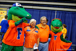 Albert and Alberta pose with some a couple Florida Gator fans during the 2014 Florida Gator Fan Day.  August 16th, 2014. Gator Country photo by David Bowie.
