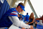 Florida Gator QB Jeff Driskel signs a poster for a fan during the 2014 Florida Gator Fan Day.  August 16th, 2014. Gator Country photo by David Bowie.