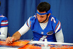 Florida Gator freshman QB Will Grier signs a poster for a fan during the 2014 Florida Gator Fan Day.  August 16th, 2014. Gator Country photo by David Bowie.