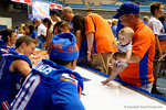 A dad and his baby son walk down the line while metting some of the Florida Gator wide revievers during the 2014 Florida Gator Fan Day.  August 16th, 2014. Gator Country photo by David Bowie.