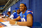 Florida Gator DL Jonathan Bullard signs a poster for a fan during the 2014 Florida Gator Fan Day.  August 16th, 2014. Gator Country photo by David Bowie.