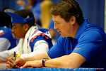 Florida Gator Head Coach Will Muschamp signs a poster for a fan during the 2014 Florida Gator Fan Day.  August 16th, 2014. Gator Country photo by David Bowie.