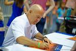 Voice of the Florida Gators, Mick Hubert signs a poster for a fan during the 2014 Florida Gator Fan Day.  August 16th, 2014. Gator Country photo by David Bowie.