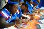 Florida Gator RB Kelvin Taylor signs a poster for a fan during the 2014 Florida Gator Fan Day.  August 16th, 2014. Gator Country photo by David Bowie.