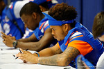 Florida Gator DB Jalen Tabor checks his phone prior to the start of the 2014 Florida Gator Fan Day.  August 16th, 2014. Gator Country photo by David Bowie.