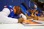 Florida Gator DL Bryan Cox, Jr. signs a poster for a fan during the 2014 Florida Gator Fan Day.  August 16th, 2014. Gator Country photo by David Bowie.