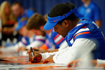 Florida Gator QB Treon Harris signs a poster for a fan during the 2014 Florida Gator Fan Day.  August 16th, 2014. Gator Country photo by David Bowie.