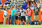Recruits watch on from the sideline during pre-game.  2014 Orange and Blue Debut.  April 12th, 2014. Gator Country photo by David Bowie.