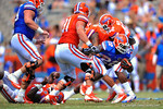 Florida RB Adam Lane Jr. tries to keep his balance after being tripped up.  2014 Orange and Blue Debut.  April 12th, 2014. Gator Country photo by David Bowie.