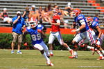 Florida QB Skyler Mornhinweg throws downfield as Gator Head Coach Will Muschamp watches on behind him.  2014 Orange and Blue Debut.  April 12th, 2014. Gator Country photo by David Bowie.