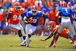 Florida WR Latroy Pittman sprints by a diving Antion Morrison and downfield.  2014 Orange and Blue Debut.  April 12th, 2014. Gator Country photo by David Bowie.