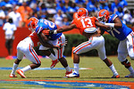 Florida RB Adam Lane Jr. runs downfield and his hit by Florida DB Nick Washington.  2014 Orange and Blue Debut.  April 12th, 2014. Gator Country photo by David Bowie.