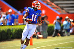 Florida WR Demarcus Robinson catches the ball and runs downfield for a touchdown.  2014 Orange and Blue Debut.  April 12th, 2014. Gator Country photo by David Bowie.