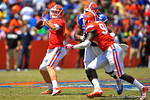 Florida QB Jeff Driskel throws downfield to an  Demarcus Robinson who takes it in for a touchdown.  2014 Orange and Blue Debut.  April 12th, 2014. Gator Country photo by David Bowie.