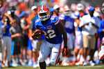 Florida RB Adam Lane Jr. sprints downfield with the ball.  2014 Orange and Blue Debut.  April 12th, 2014. Gator Country photo by David Bowie.