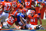 Florida RB Adam Lane Jr. runs into a pile of orange jerseys as Florida DB Marcell Harris makes the tackle.  2014 Orange and Blue Debut.  April 12th, 2014. Gator Country photo by David Bowie.