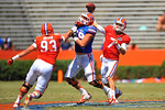 Florida OL Nick Davis takes a hand to the chin from Gator Dallas Stubbs but still gives the enough time for Florida QB Will Grier to fire the ball downfield.  2014 Orange and Blue Debut.  April 12th, 2014. Gator Country photo by David Bowie.