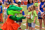 Children from the Children's Miracle Network join the Gators for a pre-game tunnel.  2014 Orange and Blue Debut.  April 12th, 2014. Gator Country photo by David Bowie.