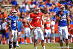 Florida Team Blue players RB Darius Masline, QB Will Grier and WR Michael McNeely look to the sideline for the play call.  2014 Orange and Blue Debut.  April 12th, 2014. Gator Country photo by David Bowie.