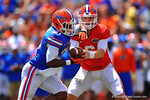 Florida QB Jeff Driskel hands the ball of to RB Kelvin Taylor who takes the ball in for a 1-yard touchdown.  2014 Orange and Blue Debut.  April 12th, 2014. Gator Country photo by David Bowie.