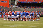 The Gators gather at mid-field before the start of the game.  2014 Orange and Blue Debut.  April 12th, 2014. Gator Country photo by David Bowie.