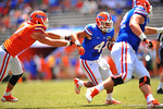 Florida FB Hunter Joyer gets the handoff and eludes the tackle attempt of Florida DL Jordan Sherit.  2014 Orange and Blue Debut.  April 12th, 2014. Gator Country photo by David Bowie.