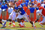 Florida RB Mack Brown gets the handoff and cuts downfield.  2014 Orange and Blue Debut.  April 12th, 2014. Gator Country photo by David Bowie.