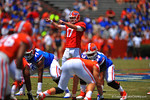 Florida QB Skyler Mornhinweg points out the defense moving and makes the adjustment at the line.  2014 Orange and Blue Debut.  April 12th, 2014. Gator Country photo by David Bowie.