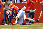 Florida DB Jabari Gorman cathes up to RB Mack Brown and knocks him out of bounds.  2014 Orange and Blue Debut.  April 12th, 2014. Gator Country photo by David Bowie.