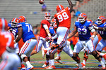 Florida QB Jeff Driskel throws over the arm of jumping Florida DL Jay-nard Bostwick and downfield.  2014 Orange and Blue Debut.  April 12th, 2014. Gator Country photo by David Bowie.