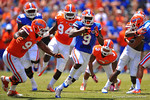 Florida WR Latroy Pittman cuts to his left and eludes the tackle of Florida DL Jay-nard Bostwick.  2014 Orange and Blue Debut.  April 12th, 2014. Gator Country photo by David Bowie.