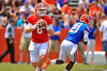 Florida QB Jeff Driskel rolls out right looking downfield.  2014 Orange and Blue Debut.  April 12th, 2014. Gator Country photo by David Bowie.