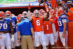 Florida DL Dante Fowler, Jr. signals to the crowd as he leads the Gators out of the tunnel.  2014 Orange and Blue Debut.  April 12th, 2014. Gator Country photo by David Bowie.