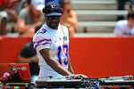 DJ Irie, official DJ of the Miami Heat, provided the music for the pre-game.  2014 Orange and Blue Debut.  April 12th, 2014. Gator Country photo by David Bowie.