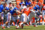 Florida WR Michael McNeely gets the reception and tries to break away from the tackles of Florida defensive backs Marquie Hawkins and Nick Washington.  2014 Orange and Blue Debut.  April 12th, 2014. Gator Country photo by David Bowie.