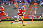 Florida QB Will Grier rolls to his left and looks downfield.  2014 Orange and Blue Debut.  April 12th, 2014. Gator Country photo by David Bowie.