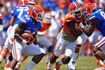 Florida RB Mack Brown gets a block from Florida TE Tevin Westbrook and cuts to his right.  2014 Orange and Blue Debut.  April 12th, 2014. Gator Country photo by David Bowie.