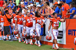 The Gators walk off the field shaking hands with the fans.  2014 Orange and Blue Debut.  April 12th, 2014. Gator Country photo by David Bowie.