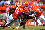 Florida DL Jay-nard Bostwick, DB Keanu Neal and LB Steven Stipe combine for the tackle on Florida RB Adam Lane Jr.  2014 Orange and Blue Debut.  April 12th, 2014. Gator Country photo by David Bowie.