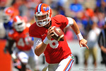 Florida QB Jeff Driskel keeps the snap and bootlegs to his left and around the corner for a first down.  2014 Orange and Blue Debut.  April 12th, 2014. Gator Country photo by David Bowie.