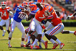 Gator DB Duke Dawson and Florida DL Bryan Cox, Jr. miss the tackle on RB Mack Brown as they tackle eachother.  2014 Orange and Blue Debut.  April 12th, 2014. Gator Country photo by David Bowie.