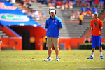 Gator Head Coach Will Muschamp coaches from 10 yards behine the line of scrimmage.  2014 Orange and Blue Debut.  April 12th, 2014. Gator Country photo by David Bowie.