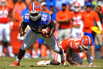 Florida RB Adam Lane Jr. spins away from the tackle attempt by DB Nick Washington.  2014 Orange and Blue Debut.  April 12th, 2014. Gator Country photo by David Bowie.