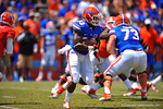 Florida RB Mack Brown looks downfield for the open lane as the sprints to the right.  2014 Orange and Blue Debut.  April 12th, 2014. Gator Country photo by David Bowie.