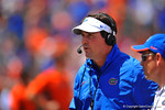 Gator Head Coach Will Muschamp looks onto the field while talking with his coaches on the headset.  2014 Orange and Blue Debut.  April 12th, 2014. Gator Country photo by David Bowie.