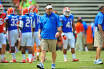 Florida Gator Head Coach Will Muschamp walks the field watching his team during pre-game.  2014 Orange and Blue Debut.  April 12th, 2014. Gator Country photo by David Bowie.